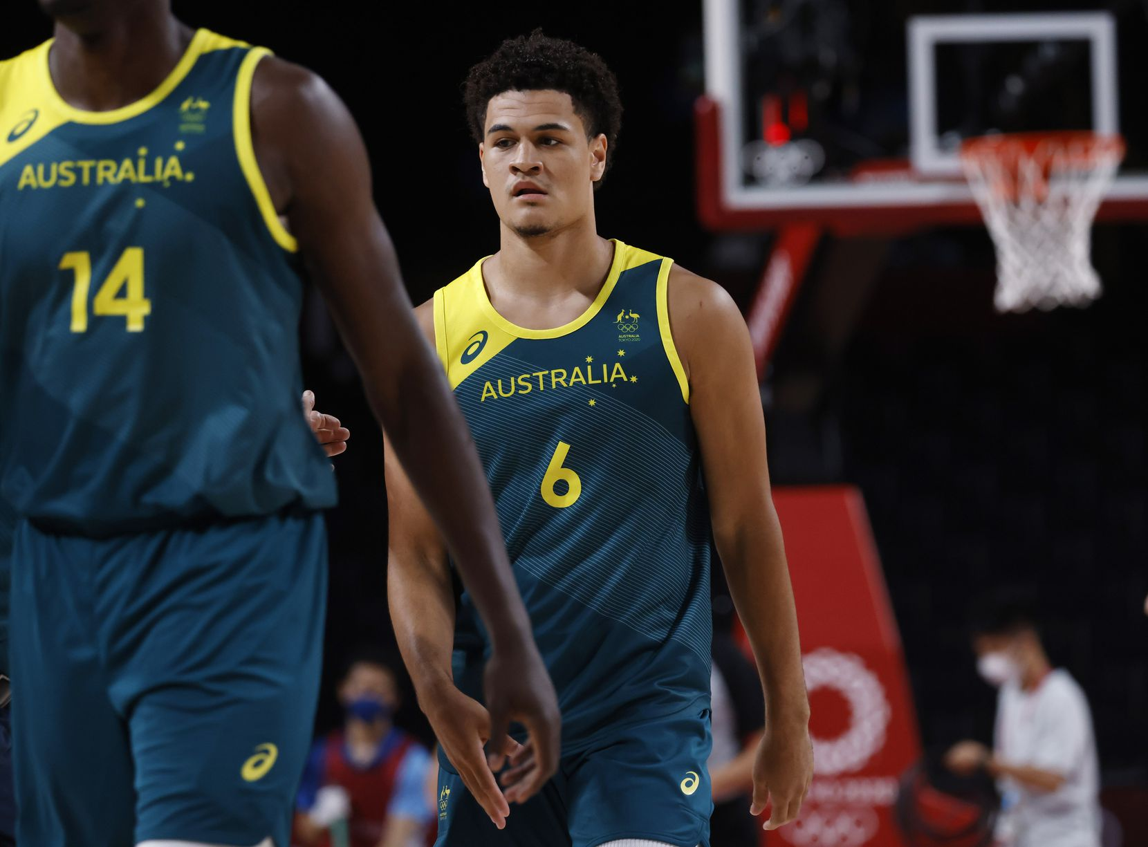 Australia's Josh Green makes his way to the bench during a timeout in a game against USA during the second half of a men's basketball semifinal at the postponed 2020 Tokyo Olympics at Saitama Super Arena, on Thursday, August 5, 2021, in Saitama, Japan. USA defeated Australia 97-78 to advance to the gold medal game. (Vernon Bryant/The Dallas Morning News)