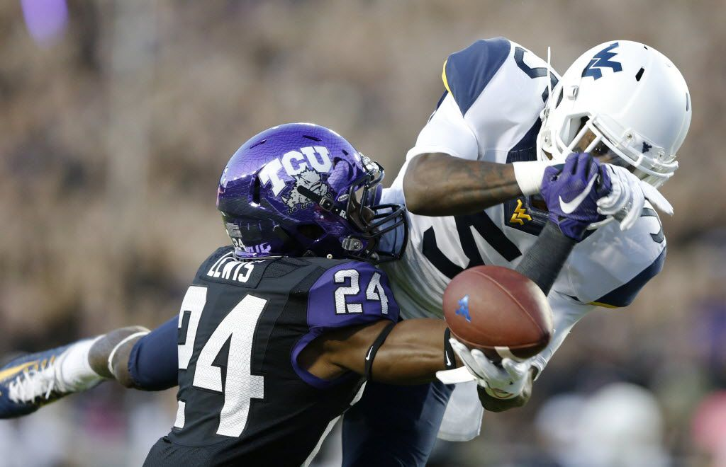 TCU Horned Frogs cornerback Julius Lewis (24) knocks the ball away from West Virginia Mountaineers wide receiver Jovon Durante (5) during the first half of play Amon G. Carter Stadium in Fort Worth, on Thursday, October 29, 2015. (Vernon Bryant/The Dallas Morning News)