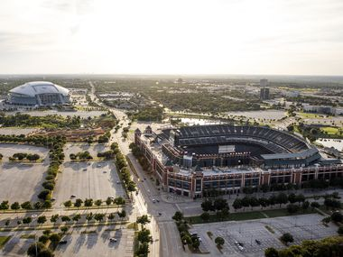 Globe Life Park (right) and AT&T Stadium (top, left) are seen with construction on the Texas Live mixed-used development complex on Thursday, July 27, 2017, in Arlington, Texas.