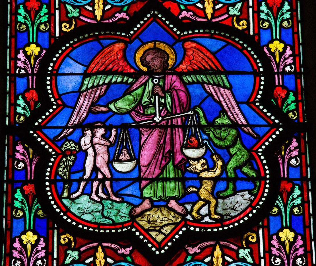 Stained glass window depicting Saint Michael the Archangel at the Final Judgement, in Bayeux, Calvados, France. This window was created in the 19th Century.