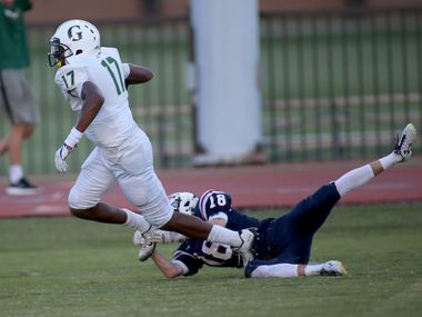 Fort Worth Country Day's Turner Symonds, 18, misses a shoestring tackle of Greenhill School's Kassidy Woods, 17, touchdown run in game action Friday, September 16, 2016, at FWCD.