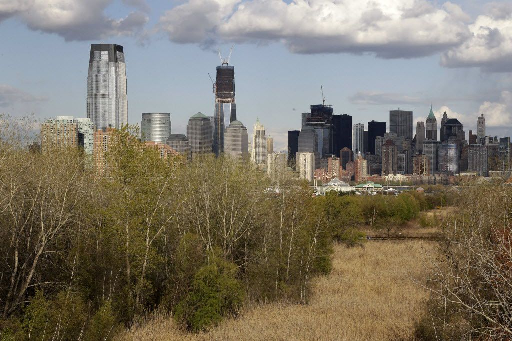 This photo taken Thursday, April 12, 2012, shows the Jersey City and New York City skylines with the green area near Liberty State Park in Jersey City, N.J. in the foreground.