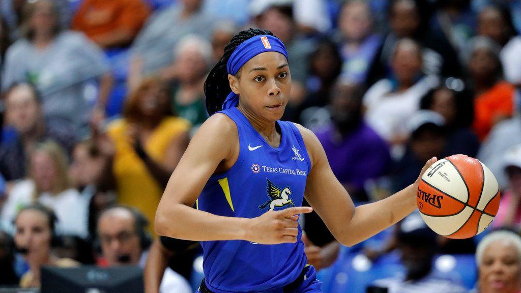 Dallas Wings' Allisha Gray handles the ball during a WNBA basketball game against the Los Angeles Sparks in Arlington, Texas, Wednesday, Aug. 14, 2019. (AP Photo/Tony Gutierrez)