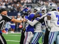 Dallas Cowboys' Damontae Kazee (18) and New York Giants' Kadarius Toney (89) get into a fight while referees and teammtes try to separate them during the 4th quarter of the game at AT&T stadium in Arlington on Sunday, October 10, 2021.