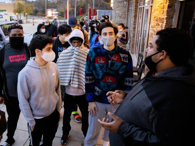 From left: Pedro Collazo, George Garrido, Clinton Mark, Fabian Reyher and Brandon Lopez discuss the differences between the new Xbox and the PlayStation 5 Friday morning after waiting in line since Thursday at the Timber Creek Crossing GameStop.