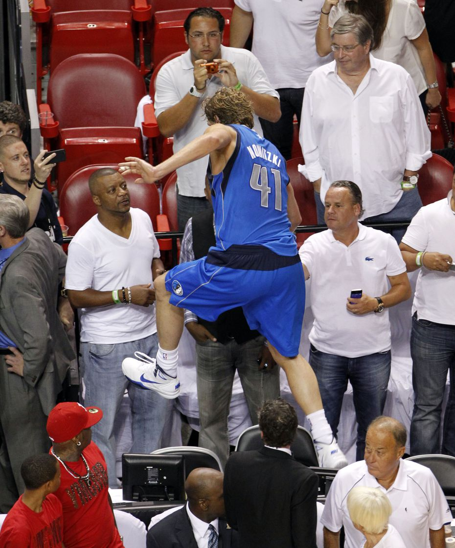 Dirk Nowitzki (41) abruptly leaves the court at the end of Game 6 of the NBA Finals at AmericanAirlines Arena in Miami on June 12, 2011.