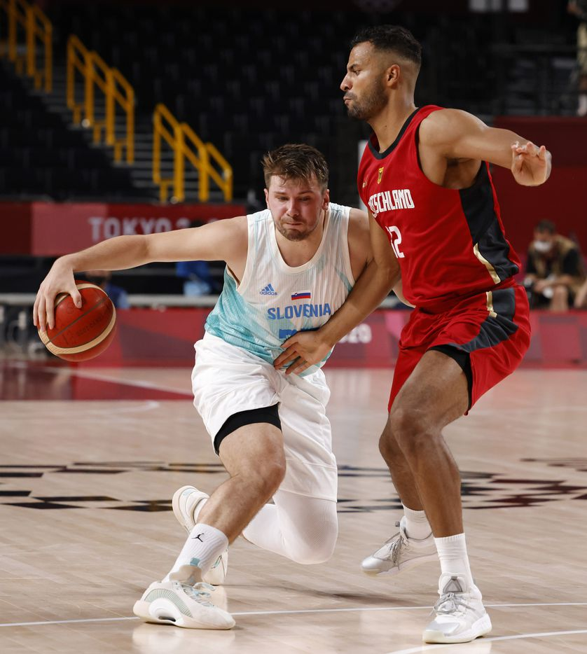 Slovenia's Luka Doncic (77) drives on Germany's  during the second half of play of a quarter final basketball game at the postponed 2020 Tokyo Olympics at Saitama Super Arena, on Tuesday, August 3, 2021, in Saitama, Japan. (Vernon Bryant/The Dallas Morning News)