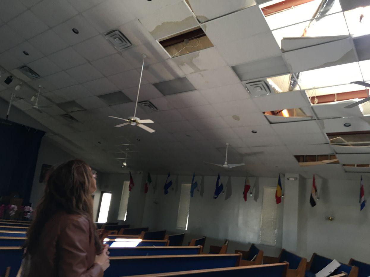 Associate pastor Ruth Lara examines tornado damage to Primera Iglesia Dallas on Oct. 21, 2019.
