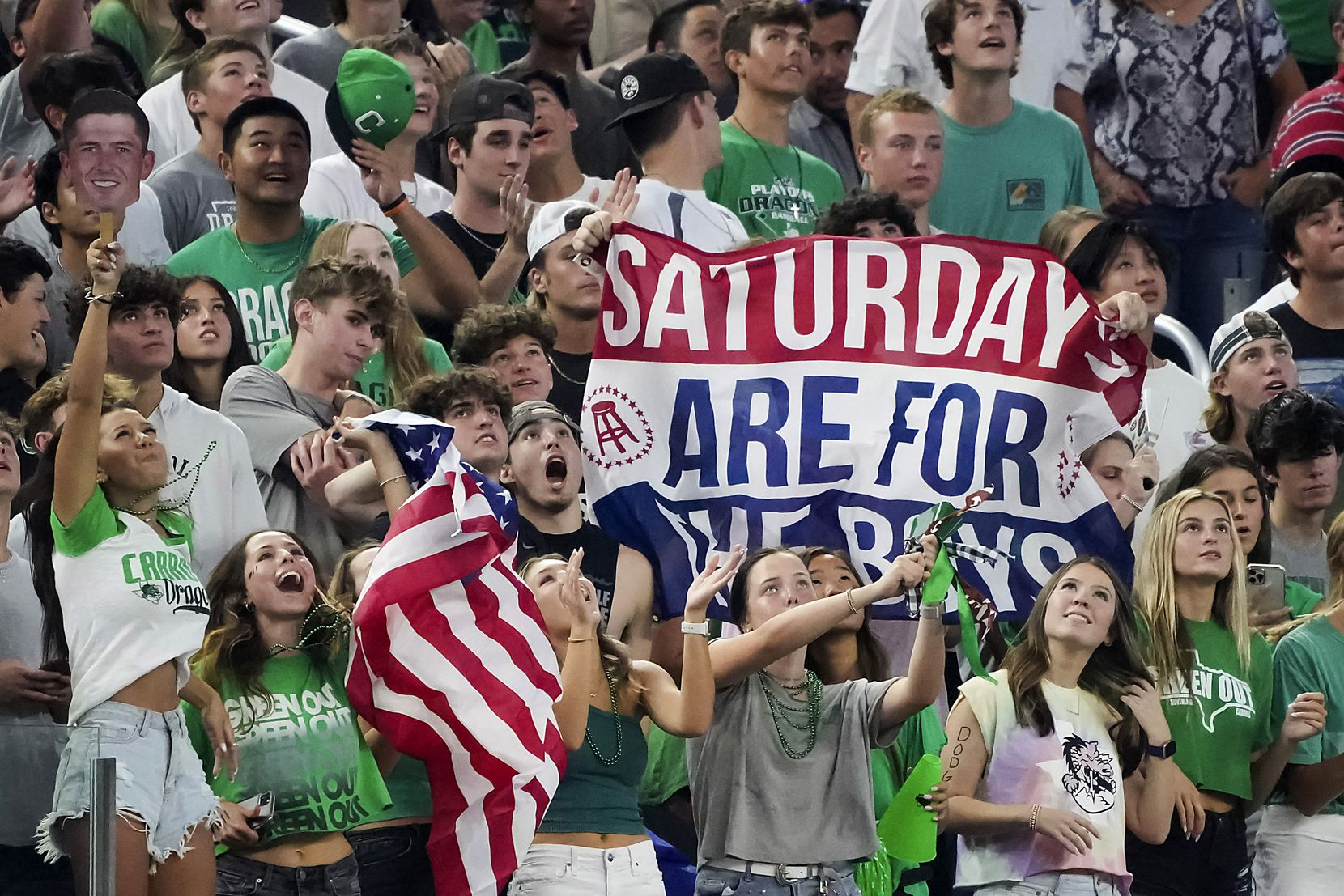 Southlake Carroll fans cheer their team during the first half of a high school football game against Highland Park at AT&T Stadium on Thursday, Aug. 26, 2021, in Arlington.