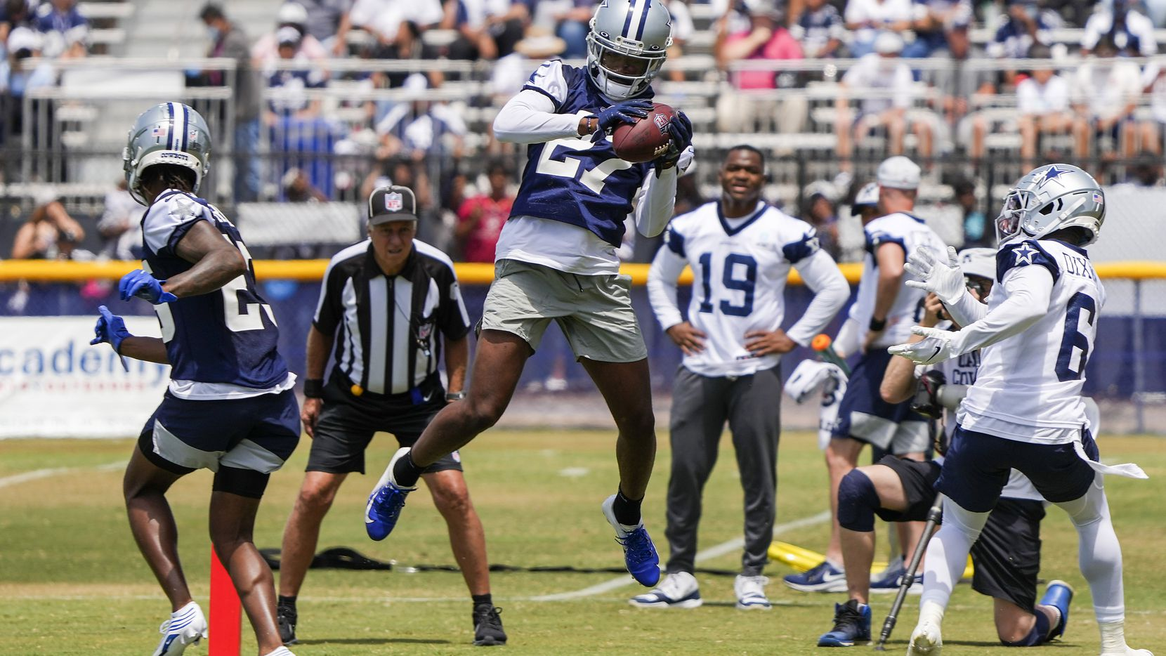 Dallas Cowboys cornerback Trevon Diggs (27) intercepts a pass intended for wide receiver Johnnie Dixon (6) in the end zone during a practice at training camp on Tuesday, July 27, 2021, in Oxnard, Calif.