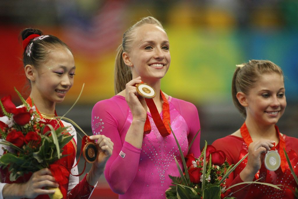 U.S. gymnast Nastia Liukin wins the gold medal in the Women's Individual All-Around at the National Indoor Stadium, Friday, August 15, 2008.  Yang Yilin of China won Bronze , left, and Shawn Johnson of the the USA won silver.