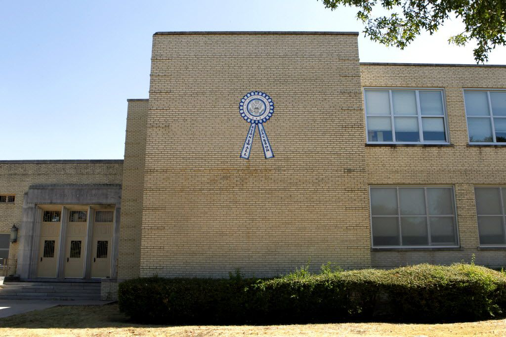 """A sign touts Stonewall Jackson Elementary School in Dallas as a """"National Blue Ribbon School of Excellence"""" back in 2011. (Lara Solt/The Dallas Morning News)"""