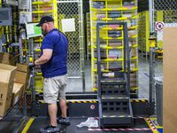 Amazon employee organized packages at an Amazon fulfillment center in Bethel Road in Grapevine.