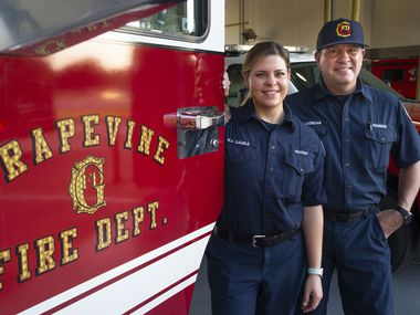 Firefighter driver-engineer and EMT Morris Leondar and his daughter, firefighter paramedic Marissa Sauble, pose for a portrait at Fire Station 1 in Grapevine, Texas, on Saturday, Aug. 8, 2020. Leondar and Sauble are the first father-daughter duo to work together at the Grapevine Fire Department.