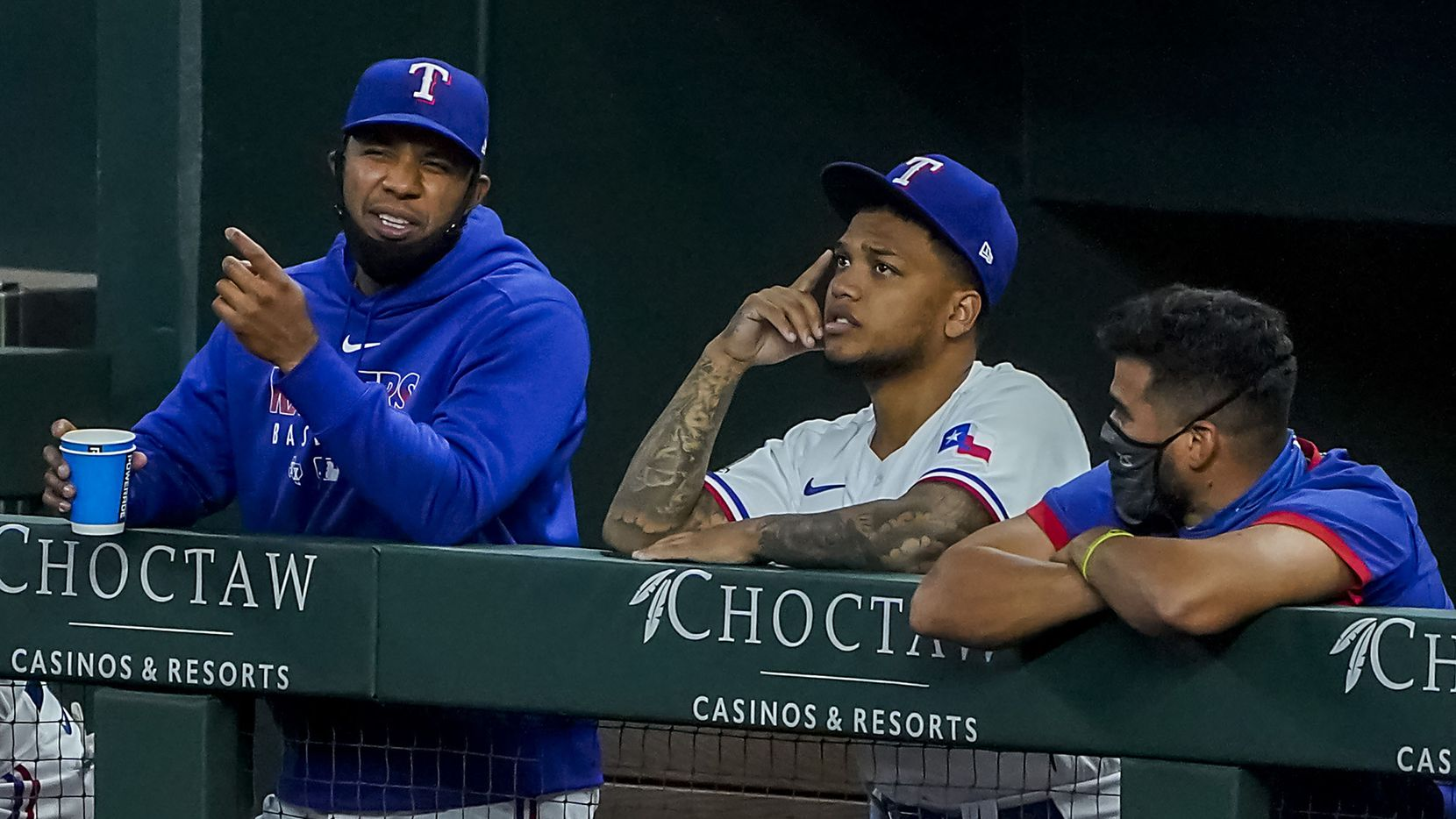Texas Rangers shortstop Elvis Andrus (left) watches from the dugout with outfielder Willie Calhoun and catcher Robinson Chirinos during the seventh inning against the San Diego Padres at Globe Life Field on Tuesday, Aug. 18, 2020.