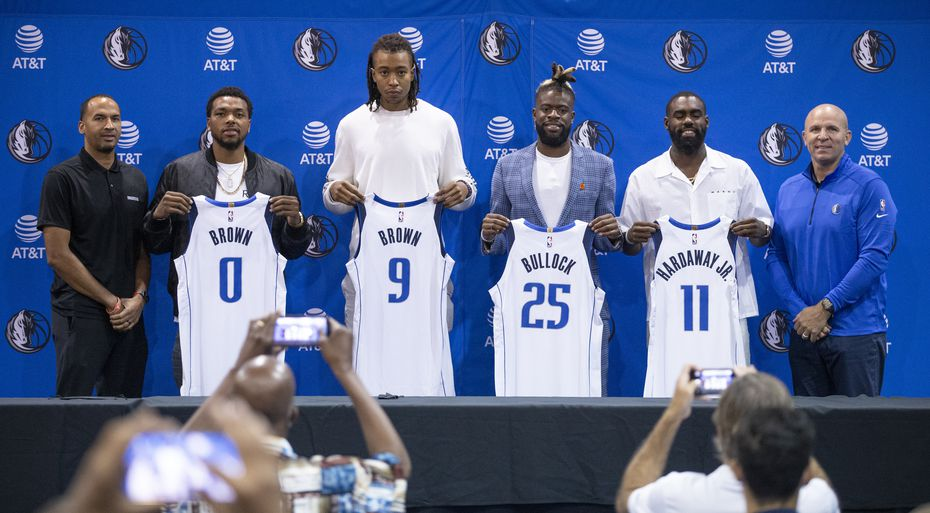 (L to R) Dallas Mavericks General Manager Nico Harrison, forwards Sterling Brown, Moses Brown, Reggie Bullock, guard Tim Hardaway Jr. and head coach Jason Kidd pose for a photo during a press conference in Dallas, Friday, August 27, 2021. (Brandon Wade/Special Contributor)
