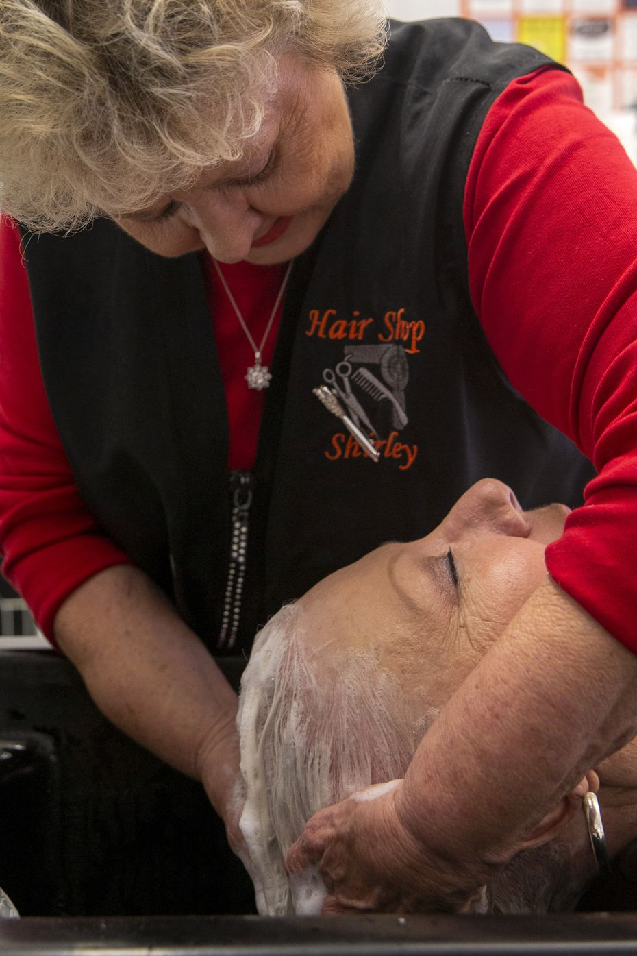 O'Neal washes Joyce Farquhar's hair. Earlier this month, O'Neal received the Texas Treasure Business Award from the Texas Historical Commission, which is given to businesses in continuous operation for more than a half-century.