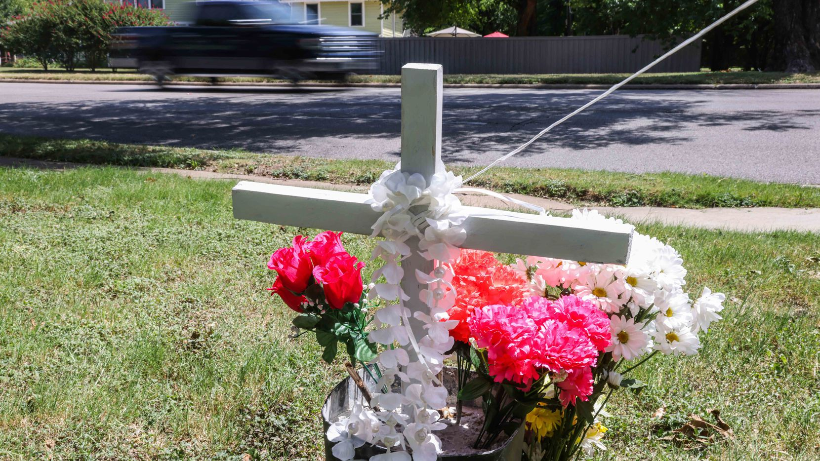 A makeshift memorial honoring Armando Leija near the intersection of West Jefferson Boulevard and Winnetka Avenue in Dallas on Saturday, July 24, 2021. Leija was on a lawnmower cutting grass when he was hit by a car that lost control and went off the road.