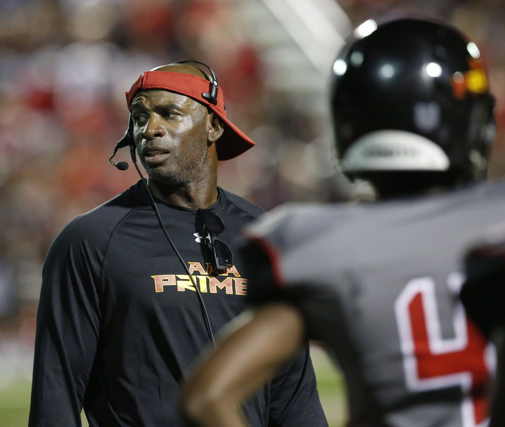 AAA Prime U coach Deion Sanders communicated with his players during a high school football game against Fort Worth Christian in North Richland Hills.