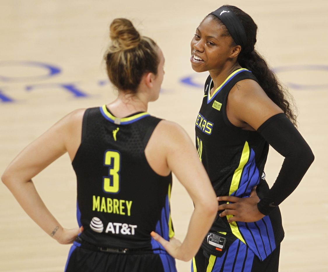 Dallas Wings guards Arike Ogunbowale (24), right, and Marina Mabrey (3) share a light moment before play resumed from a first half timeout in their game against the Atlanta Dream. The two teams played their WNBA game at College Park Center on the campus of UT-Arlington on September 5, 2021. (Steve Hamm/ Special Contributor)