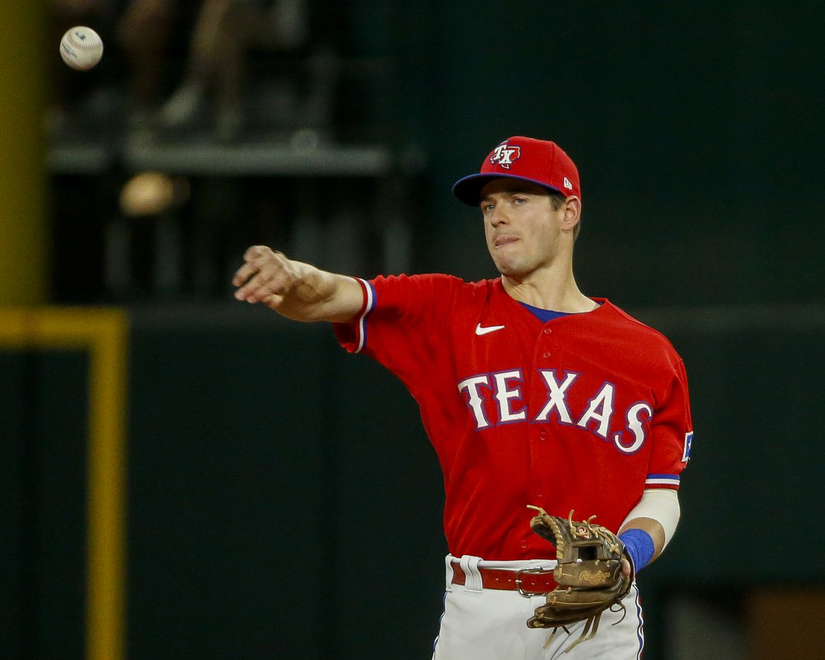 Texas Rangers second baseman Nick Solak (15) throws the ball around the bases during the sixth inning against the Kansas City Royals at Globe Life Field on Friday, June 25, 2021, in Arlington. (Elias Valverde II/The Dallas Morning News)