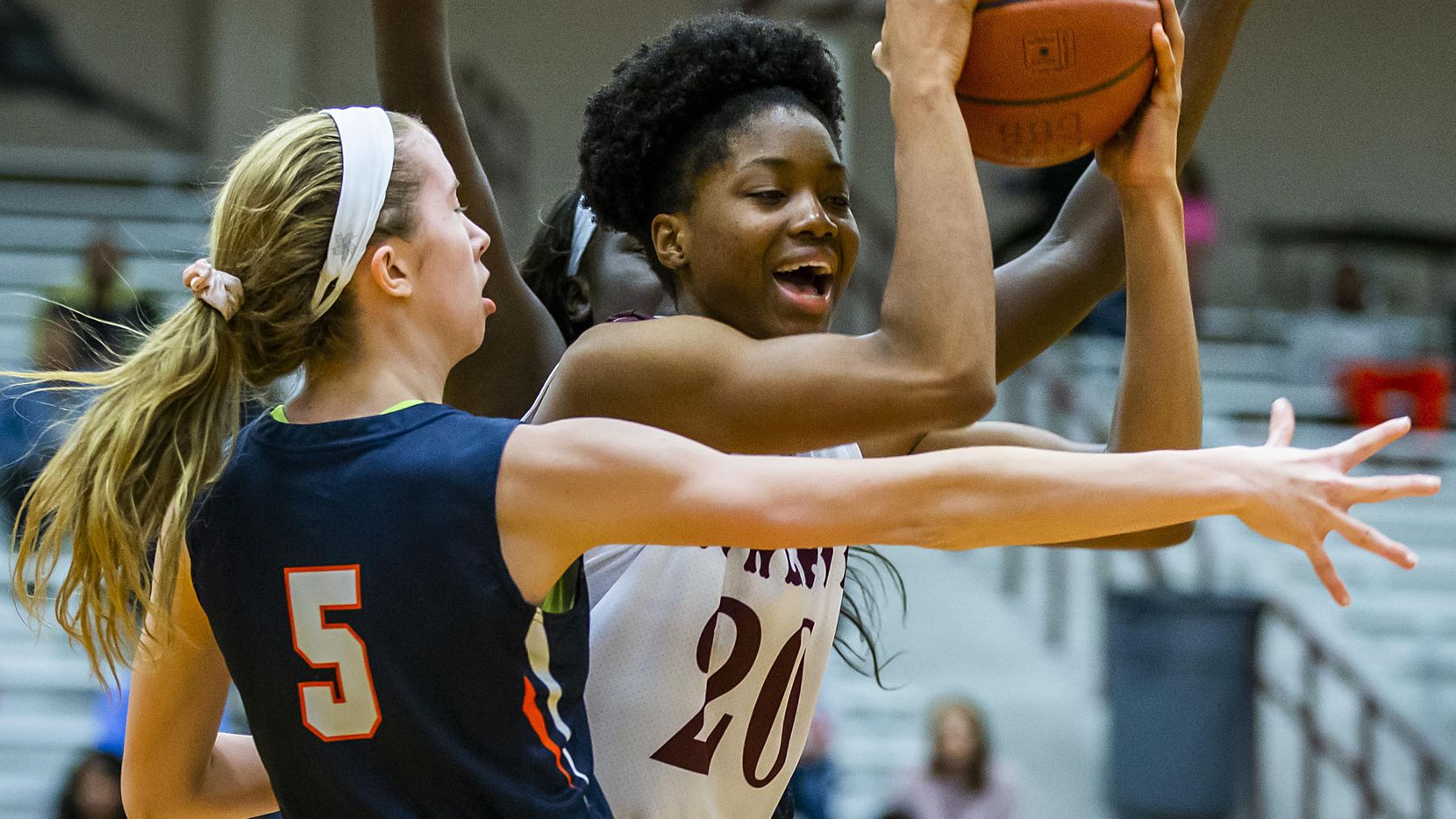 Rowlett forward Ngozi Obineke (20) is defended by Sachse guard Avery Crouse (5) during a District 10-6A girls basketball game on Friday, Jan. 11, 2019, in Rowlett, Texas. (Smiley N. Pool/The Dallas Morning News)