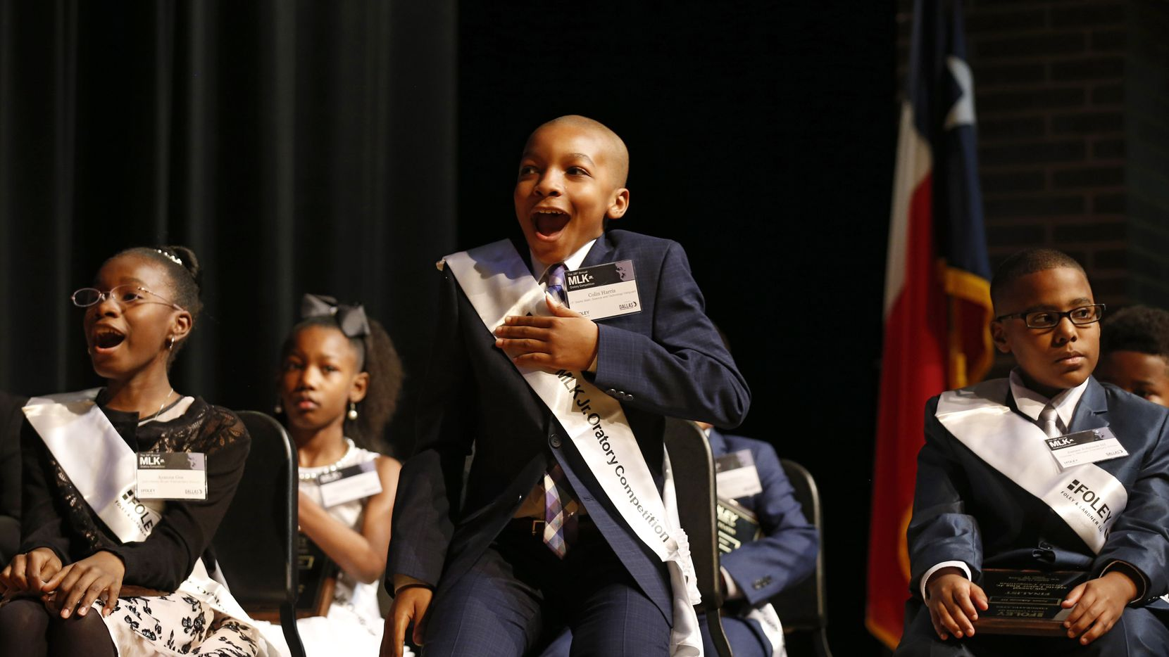 """Colin Harris of J.P. Starks Math, Science and Technology Vanguard reacts after his name is called to receive the first place award during the 28th annual MLK Jr. Oratory Competition at W.H. Adamson High School in Dallas on Friday, January 17, 2020. Eight students presented 3-5 minute speeches about the topic, """"What Would Dr. King's vision be for America in 2020."""" (Vernon Bryant/The Dallas Morning News)"""