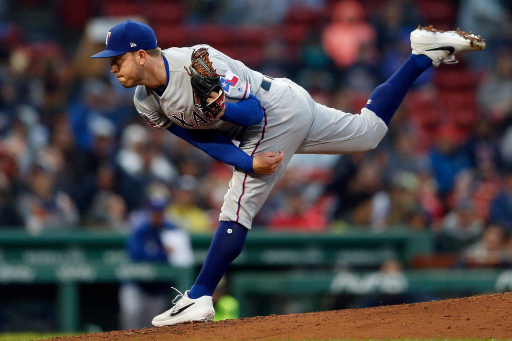 Texas Rangers' Adrian Sampson pitches during the first inning of a baseball game against the Boston Red Sox in Boston, Thursday, June 13, 2019. (AP Photo/Michael Dwyer)