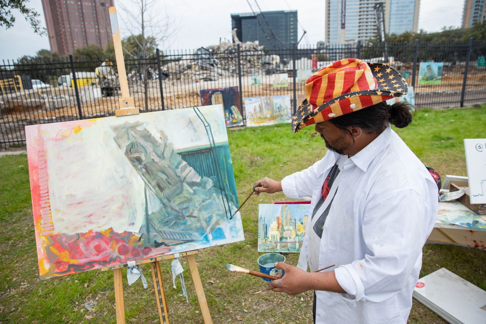 Artist Jerrel Sustaita continued to paint the Affiliated Computer Services building, or the Leaning to Tower of Dallas, at 2828 N. Haskell Ave., after it finally fell over on Mar. 02, 2020, in Dallas. (Juan Figueroa/The Dallas Morning News)