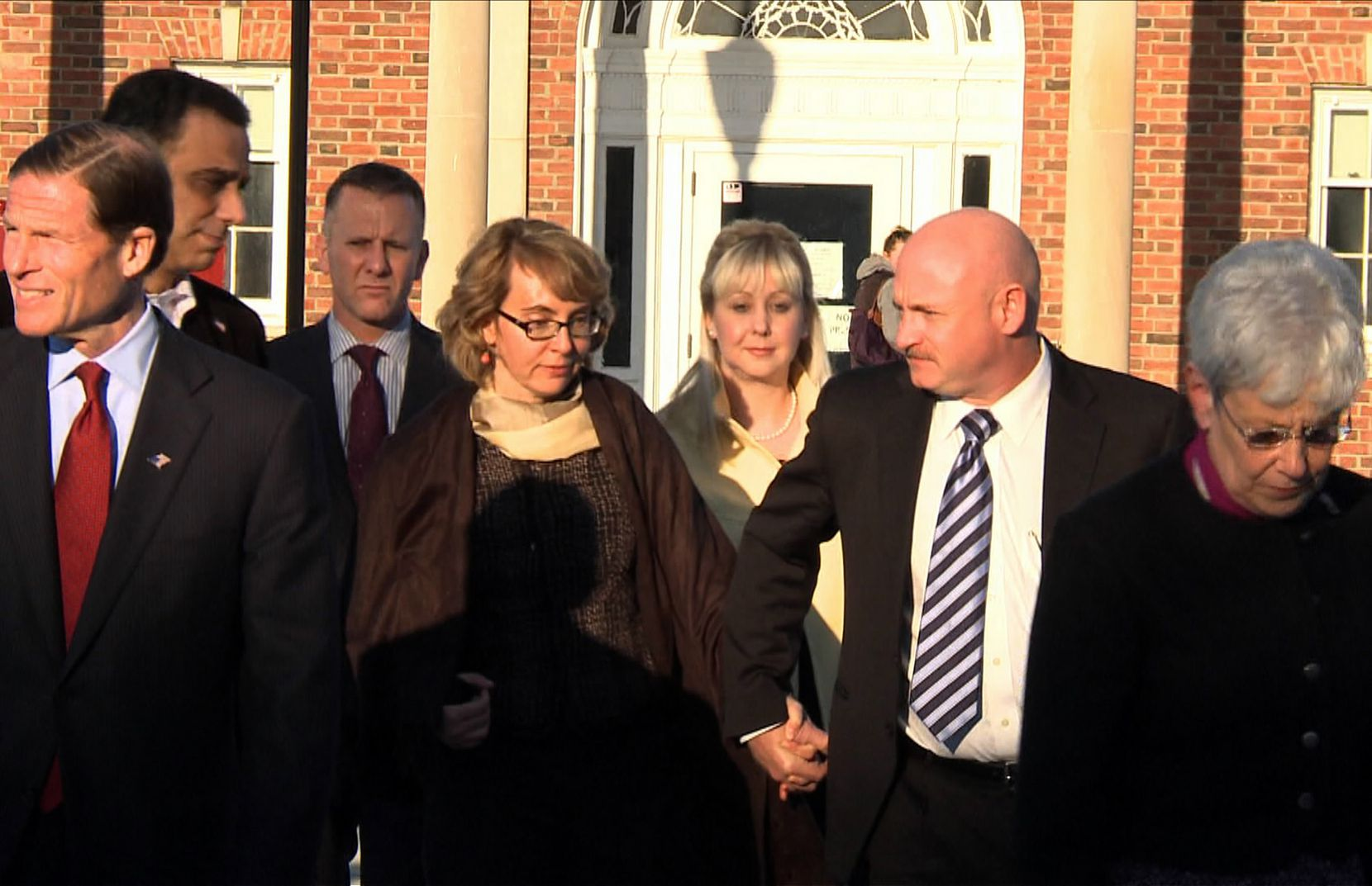 Former Arizona congresswoman Gabrielle Giffords and her husband, future Arizona Sen. Mark Kelly, leave the municipal center in Newtown, Conn., after meeting with families of victims in the Sandy Hook shootings.