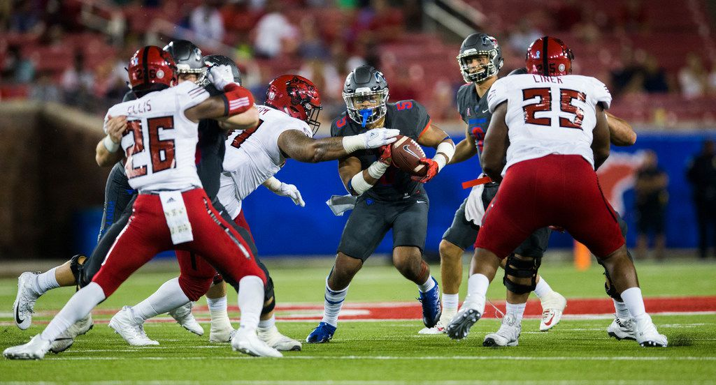 Southern Methodist Mustangs running back Xavier Jones (5) finds a gap as he runs the ball during the third quarter of a game between Arkansas State and SMU on Saturday, September 23, 2017 at Ford Stadium on the SMU campus in Dallas. (Ashley Landis/The Dallas Morning News)