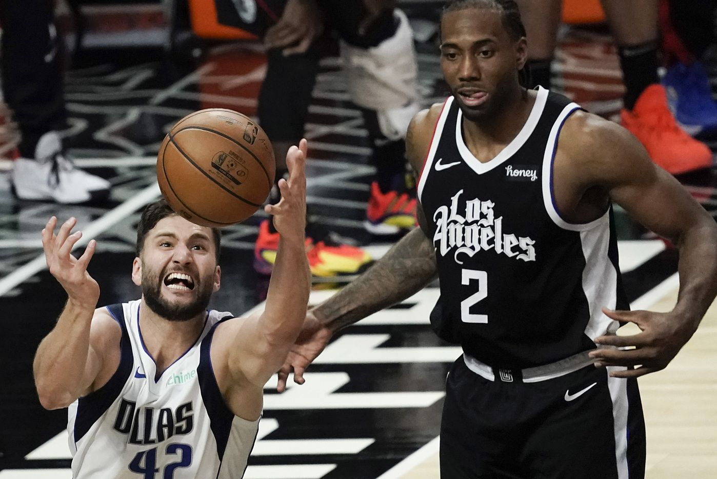 Dallas Mavericks forward Maxi Kleber (42) grabs a rebound in front of LA Clippers forward Kawhi Leonard (2) during the second half of an NBA playoff basketball game at Staples Center on Saturday, May 22, 2021, in Los Angeles. The Mavericks won the game 113-103.