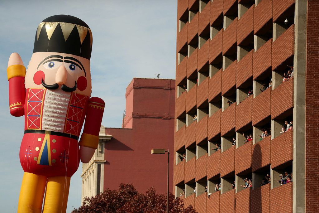 A Nutcracker inflatable is pulled through downtown Dallas during the Dallas Holiday Parade.