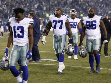 Dallas Cowboys offensive tackle Tyron Smith (77), Dallas Cowboys defensive tackle Maliek Collins (96) and Dallas Cowboys wide receiver Michael Gallup (13) exit the field after losing to the Philadelphia Eagles 17-9 at Lincoln Financial Field in Philadelphia on Sunday, December 22, 2019. (Vernon Bryant/The Dallas Morning News)