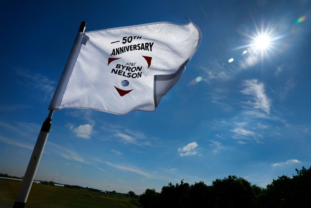 The 50th Anniversary AT&T Byron Nelson golf tournament pin flag whips in the wind at the new Trinity Forest Golf Club in Dallas Monday, April 23, 2018. The course is the new home of the Byron Nelson golf tournament. (Tom Fox/The Dallas Morning News)