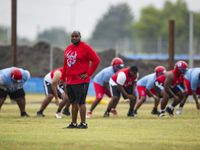 Carter head coach Spencer Gilbert watches his team during the first day of football practice at Carter High School in Dallas, Monday, August 2, 2021.