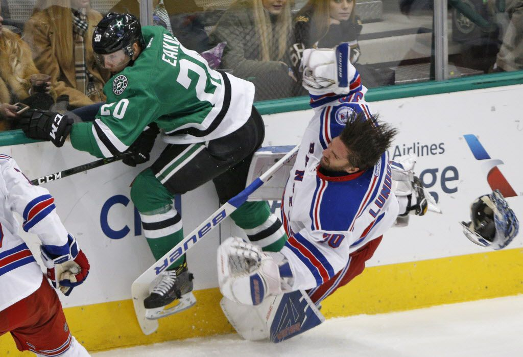 Dallas Stars center Cody Eakin (20) hits New York Rangers goalie Henrik Lundqvist (30) and knocks him out of the game for a major penalty in the first period at American Airlines Center in Dallas on December 15, 2016. (Nathan Hunsinger/The Dallas Morning News)