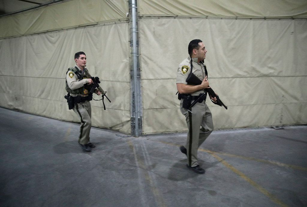 Police enter the Mandalay Bay resort and casino during a shooting near the Las Vegas Strip.