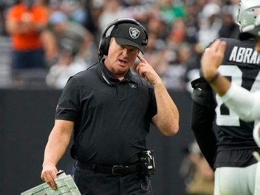 Las Vegas Raiders head coach Jon Gruden speaks on his headset during the first half of an NFL football game against the Chicago Bears, Sunday, Oct. 10, 2021, in Las Vegas.