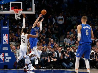 Dallas Mavericks guard Luka Doncic (77) passes the ball out to Dallas Mavericks forward Kristaps Porzingis (6) as New Orleans Pelicans center Derrick Favors (22) defends during the second half of play at American Airlines Center in Dallas on Wednesday, March 4, 2020. Dallas Mavericks defeated the New Orleans Pelicans 127-123.