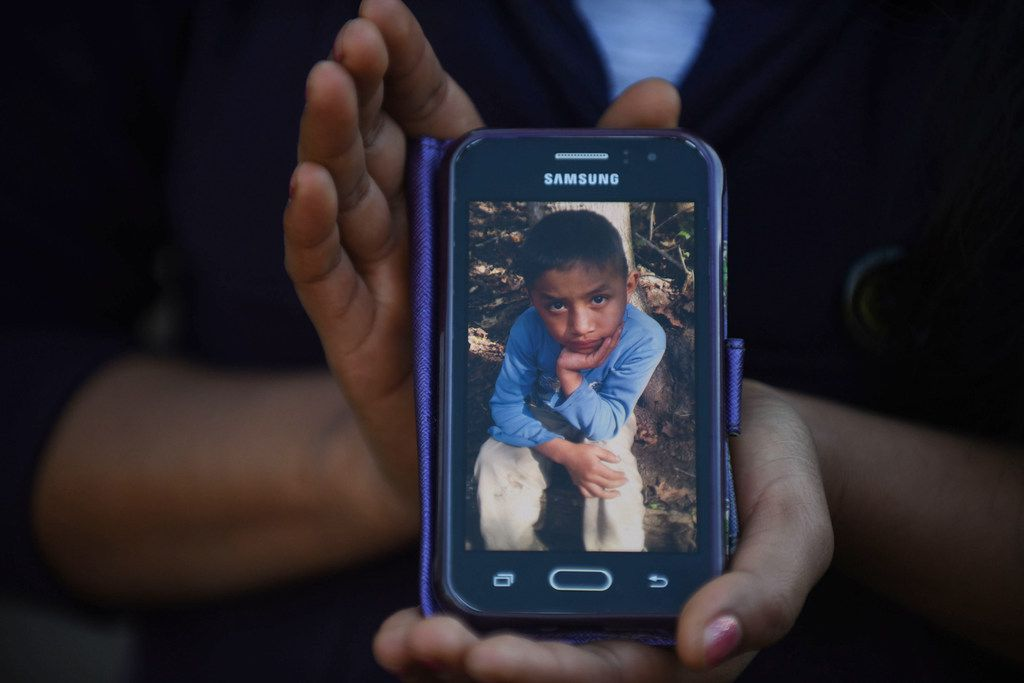Catarina Gomez Lucas, sister of eight-year-old migrant Felipe Gomez, who died in a medical center in Alamogordo, New Mexico, on December 24, while in custody of U.S. Customs and Border Protection officers, shows a picture of her brother on a mobile phone outside her house in Yalambojoch village, Nenton municipality, Huehuetenango department in Guatemala on December 28, 2018.