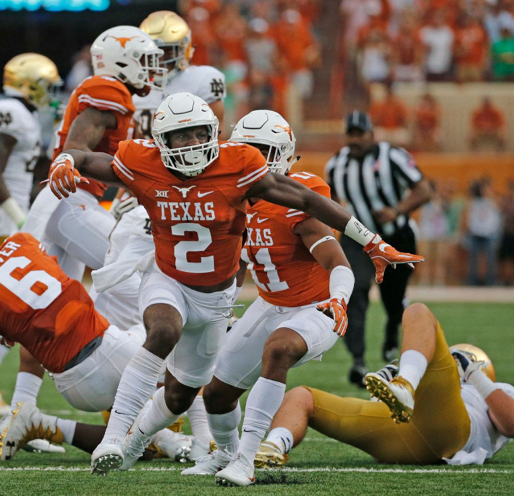 Texas cornerback Kris Boyd (2) celebrates making a tackle during the Notre Dame Fighting Irish vs. the University of Texas Longhorns NCAA football game at Darrell K. Royal Memorial Stadium in Austin on Sunday, September 4, 2016. (Louis DeLuca/The Dallas Morning News)