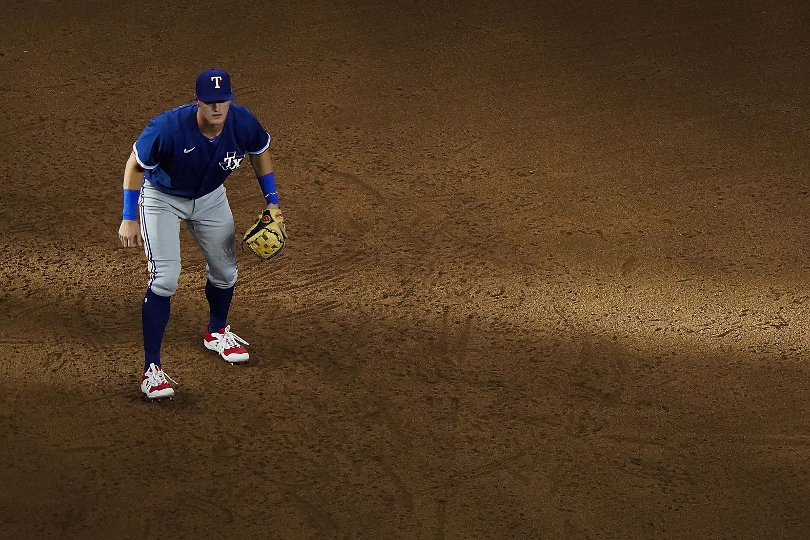 Josh Jung waits for a pitch as sunlight filters across his position at third base in an intrasquad game during Texas Rangers Summer Camp at Globe Life Field on Saturday, July 18, 2020.