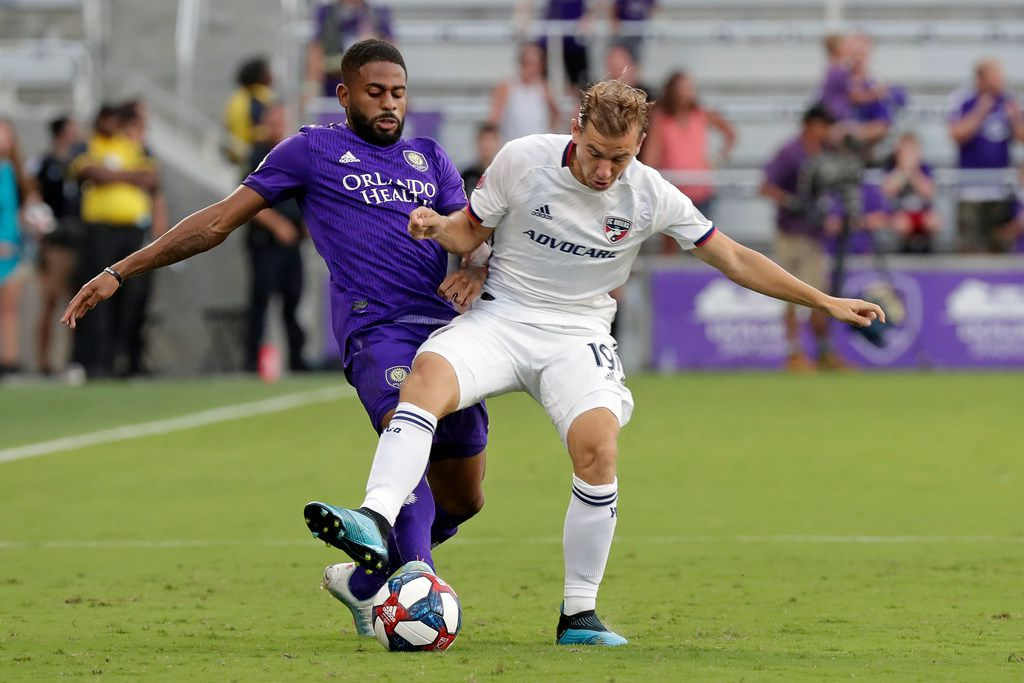 Orlando City defender Ruan, left, and FC Dallas midfielder Paxton Pomykal (19) battle for the ball during the first half of an MLS soccer match, Saturday, Aug. 3, 2019, in Orlando, Fla. (AP Photo/John Raoux)