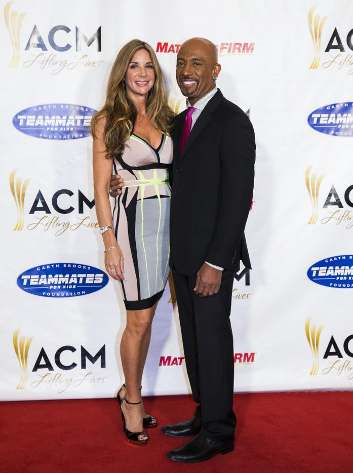 Television personality Montel Williams and his wife, Tara Fowler, pose for photos on the red carpet at the ACM Lifting Lives gala.