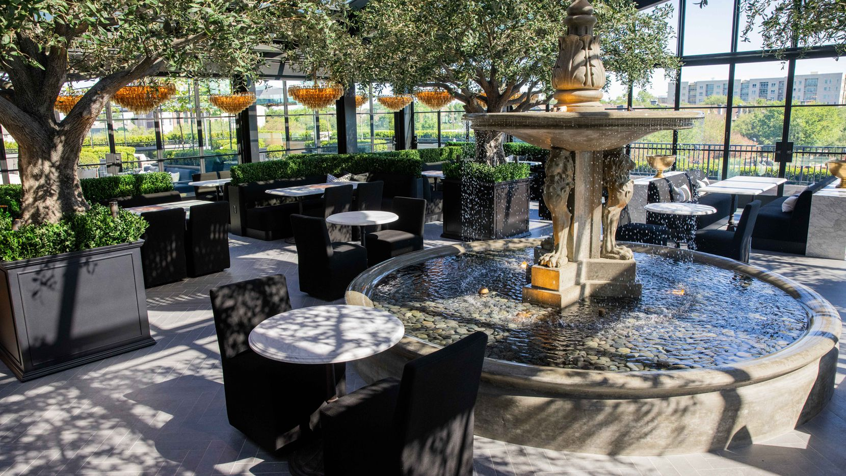 The dining area of the RH Dallas gallery rooftop restaurant. The third level includes a wine bar and open patio space.