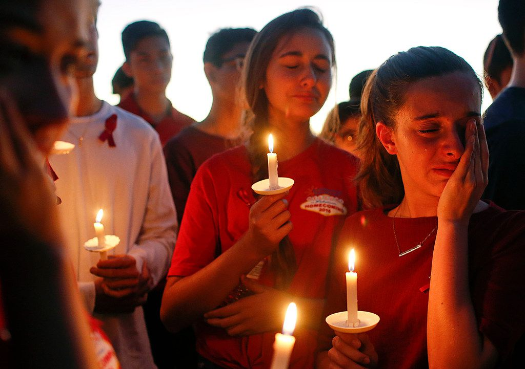 In this February, 2017, students gather to grieve during a vigil at Pine Trails Park for the victims of a shooting at Marjory Stoneman Douglas High School, in Parkland, Fla..(AP Photo/Brynn Anderson, File)