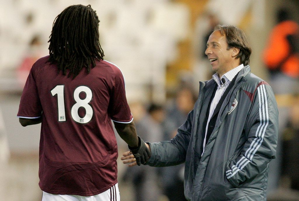 In this March 20, 2007, file photo, Colorado Rapids coach Fernando Clavijo, right, gives instructions to his player Ugo Ihemelu, left, during a friendly soccer match against Valencia at the Mestalla Stadium in Valencia, Spain. Clavijo, a surprise starter for the 1994 U.S. World Cup team who went on to a coaching and management career in Major League Soccer, died Friday, Feb. 8, 2019, at his home in Fort Lauderdale, Fla., from multiple myeloma. He was 63.