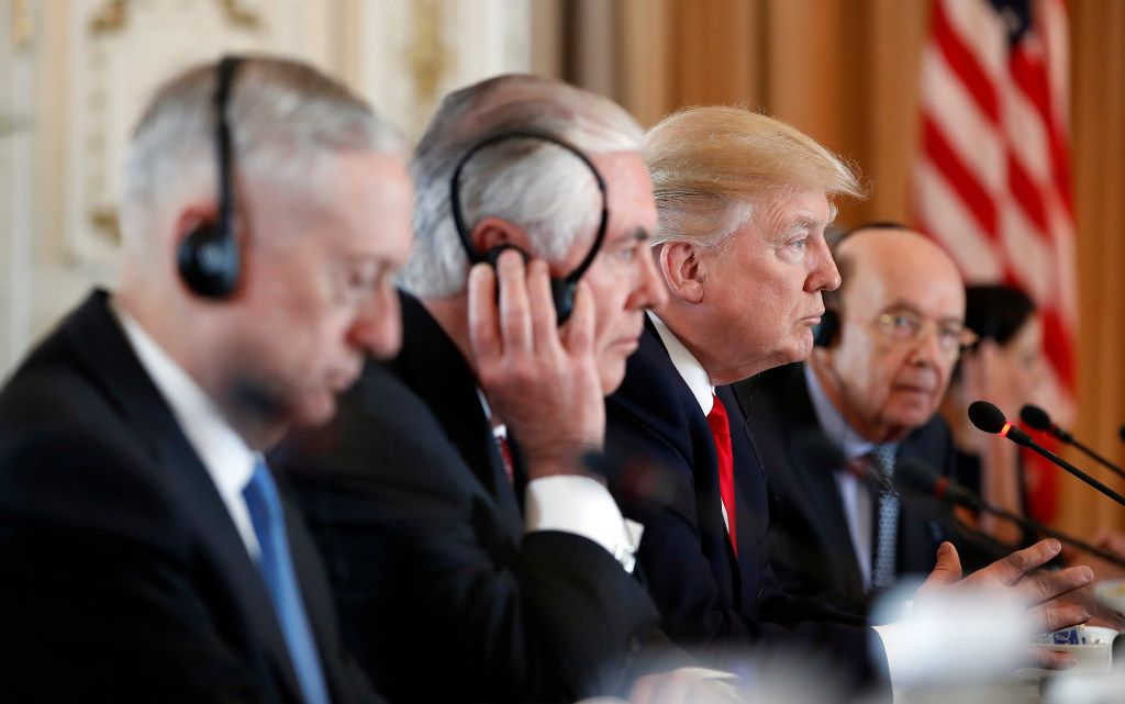 President Donald Trump, joined Defense Secretary Jim Mattis, left,  Secretary of State Rex Tillerson, second from left, and Commerce Secretary Wilbur Ross, right, listens as Chinese President Xi Jinping speaks during a bilateral meeting at Mar-a-Lago, Friday, April 7, 2017, in Palm Beach, Fla. Trump was meeting again with his Chinese counterpart Friday, with U.S. missile strikes on Syria adding weight to his threat to act unilaterally against the nuclear weapons program of China's ally, North Korea. (AP Photo/Alex Brandon)