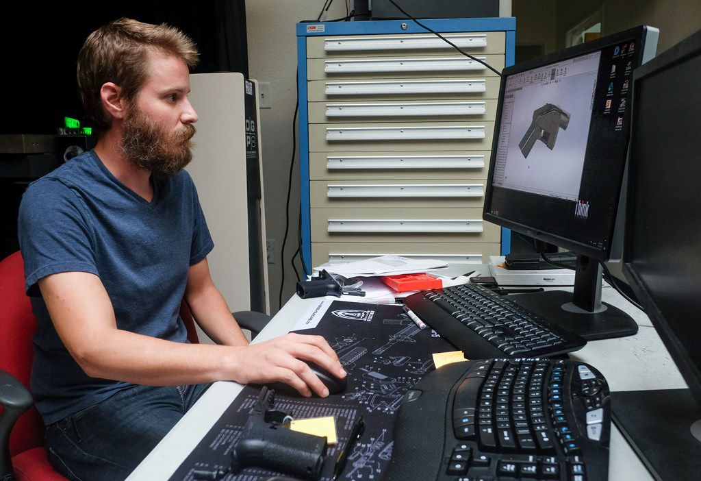 Ben Chalker, who is in charge of manufacturing, shows a part of the blueprint on a computer in Wilson's factory in Austin, Texas on August 1, 2018. A US gun rights advocate began gearing up for a legal fight Wednesday to be able to publish online blueprints for 3D-printed firearms, as the White House signaled support for a federal judge's decision to block the venture. Cody Wilson's Texas-based company Defense Distributed had briefly made the blueprints available online, but Seattle-based US District Judge Robert Lasnik granted an injunction Tuesday to take the material down.